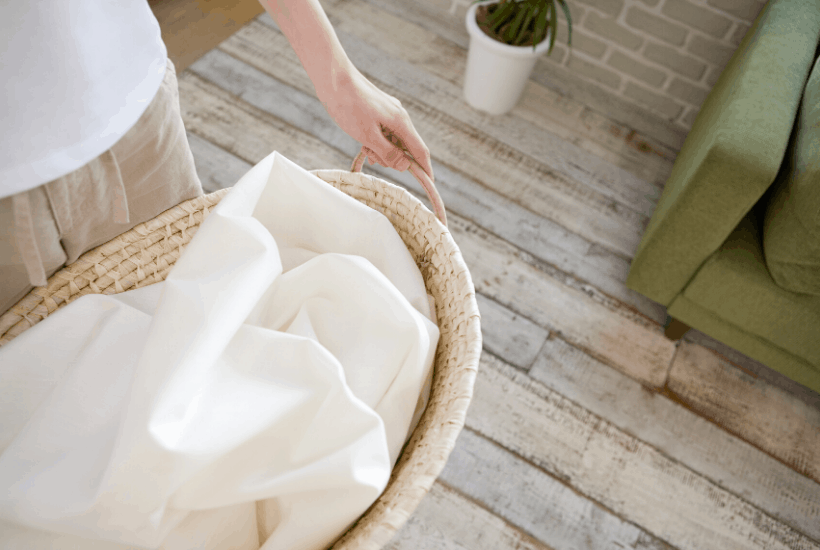 laundry basket with white towel inside