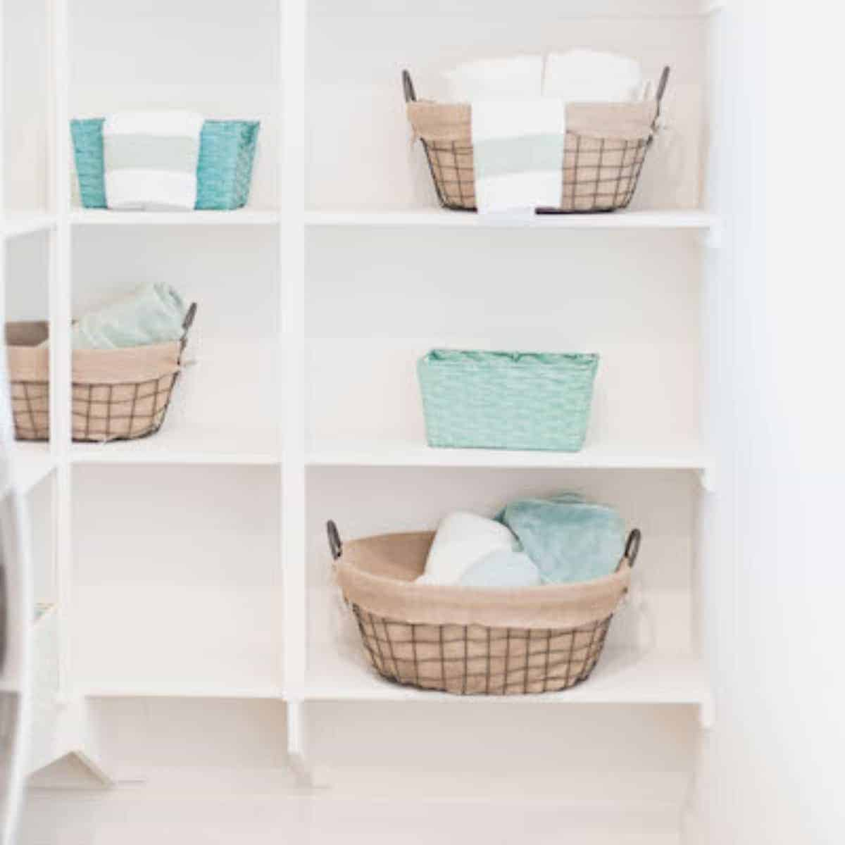 closet shelving with laundry baskets and linens