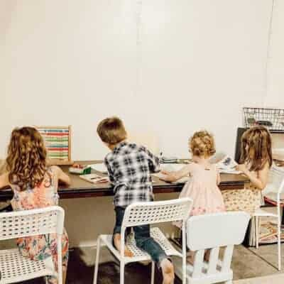 children sitting at table in classroom