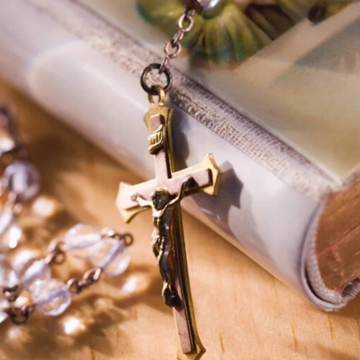 missal prayer book with rosary