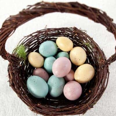 brown wicker natural easter basket filled with colorful eggs