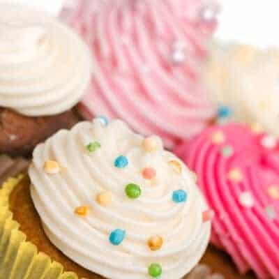 plate of colorful cupcakes