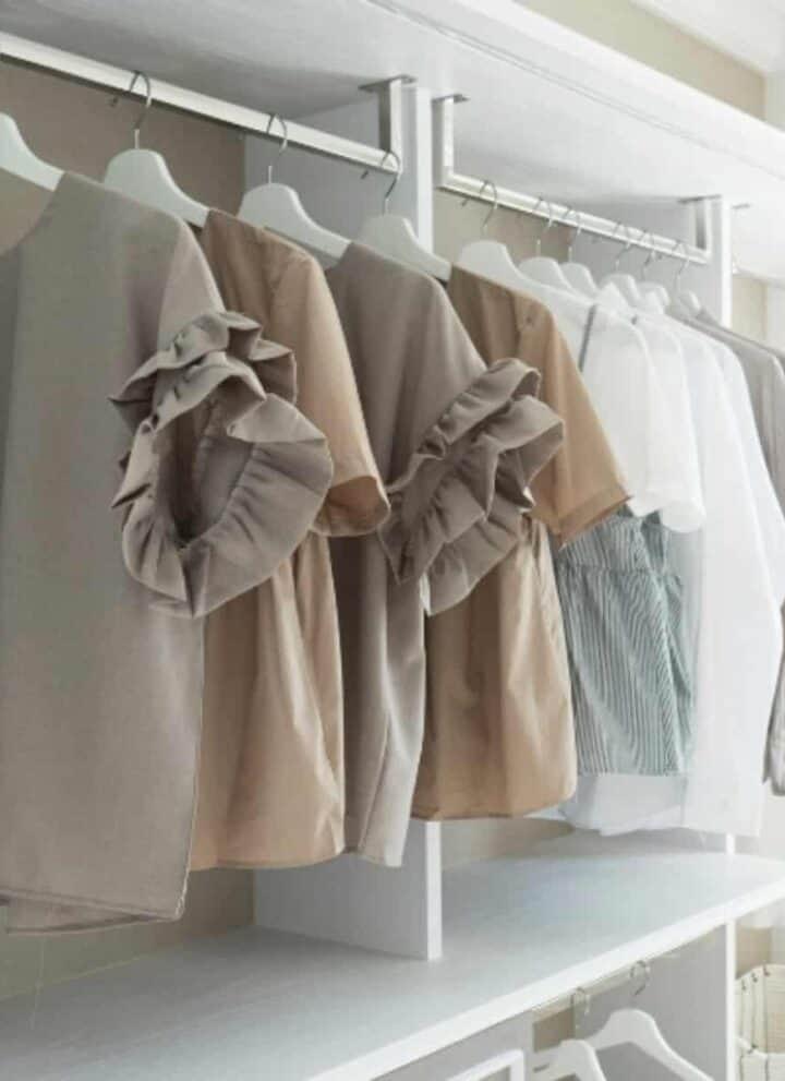 vintage capsule wardrobe hanging in the closet