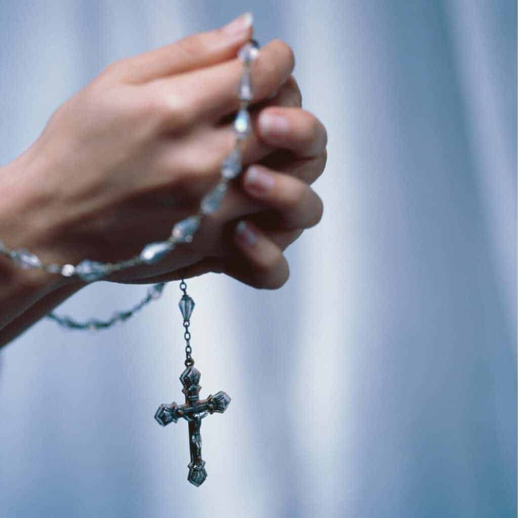 rosary in woman's hands