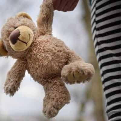 toddler holding teddy bear