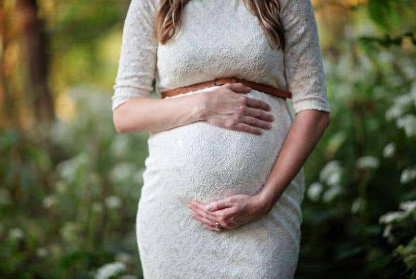 pregnant lady in a white dress