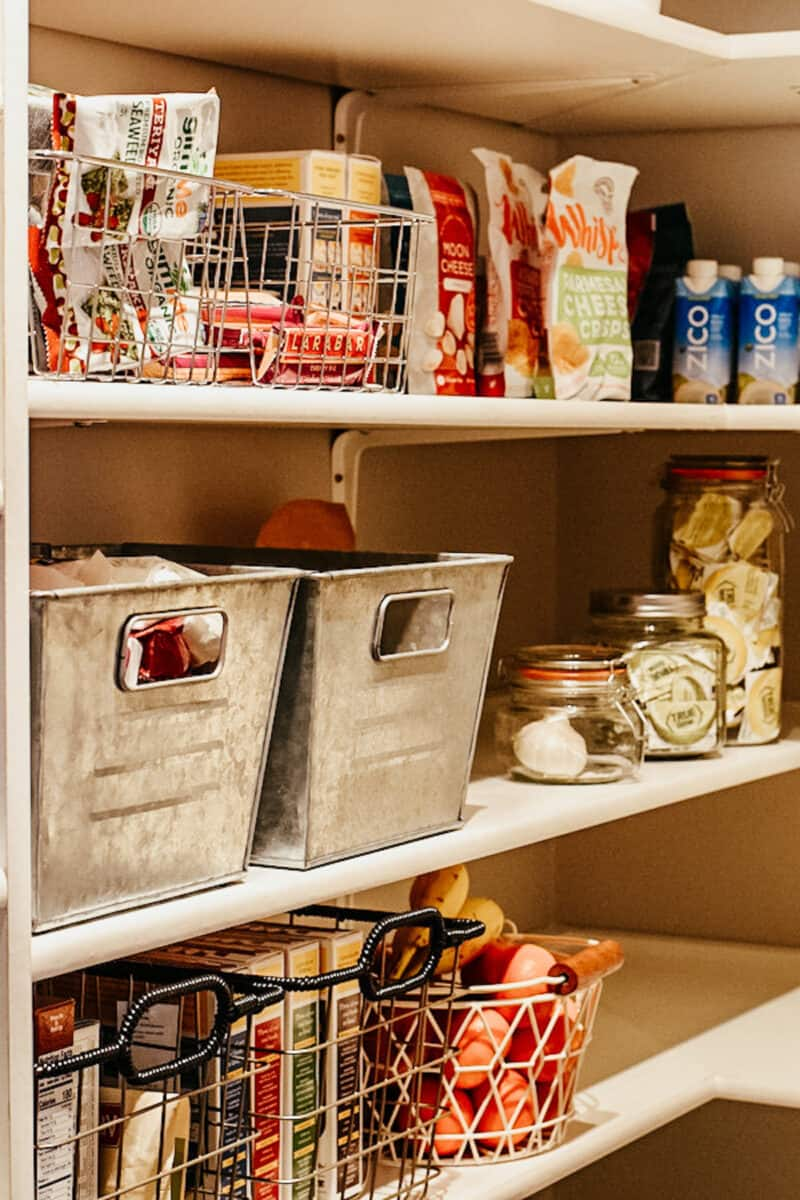 metal bins for food storage in a farmhouse pantry