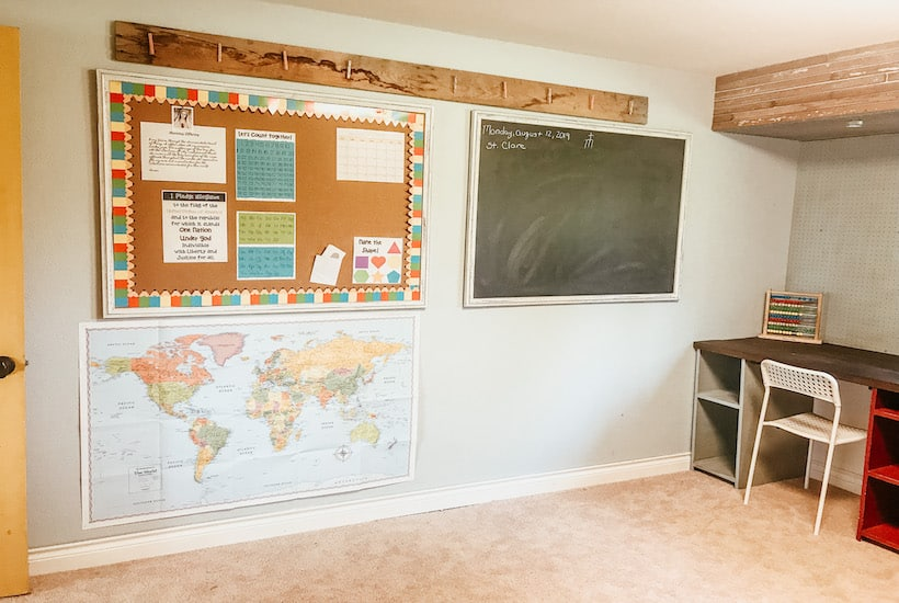 chalkboard and map wall in homeschool classroom