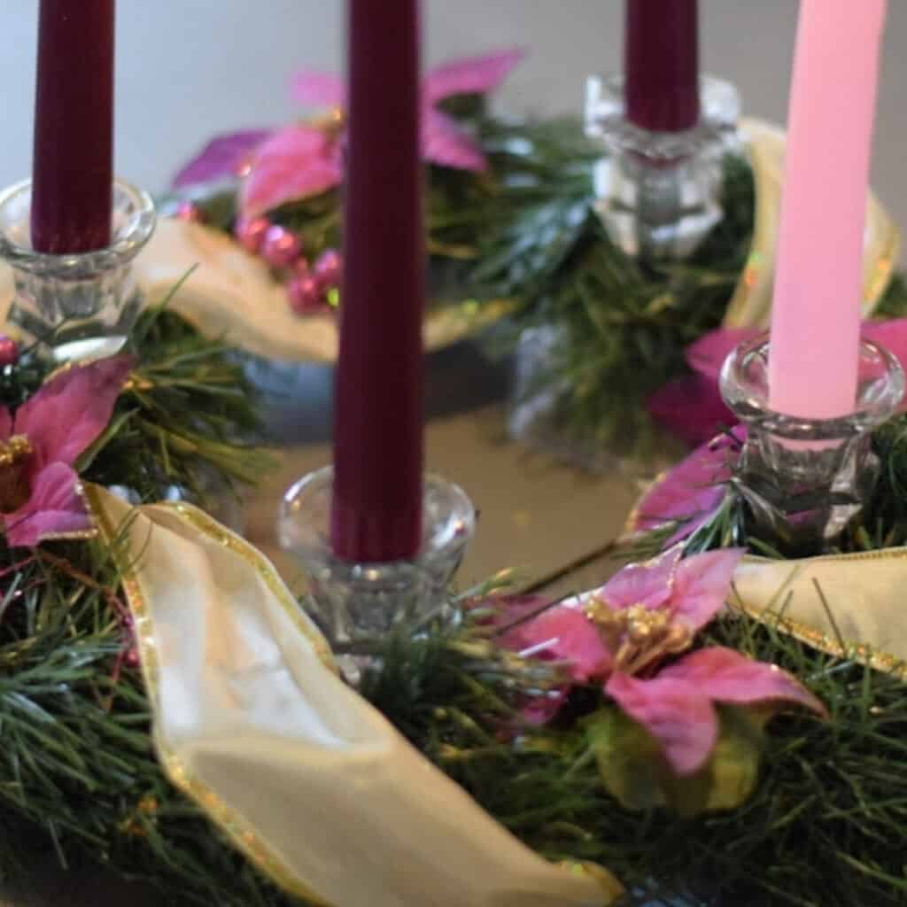 close up image of homemade advent wreath with candles