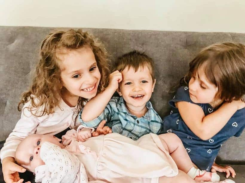 four children sitting on couch