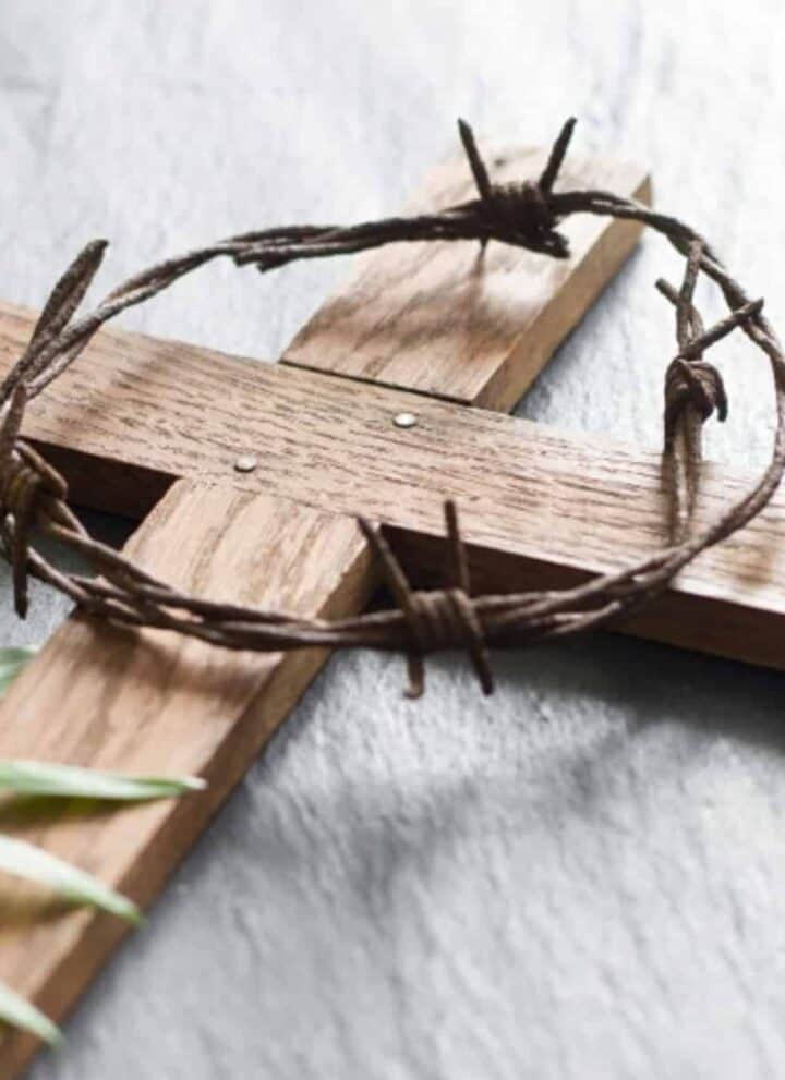 wooden cross with a crown of thorns