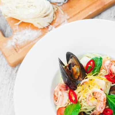 white plate of seafood pasta