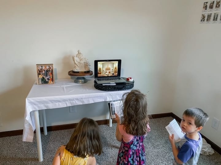 watching mass live-streamed on a laptop
