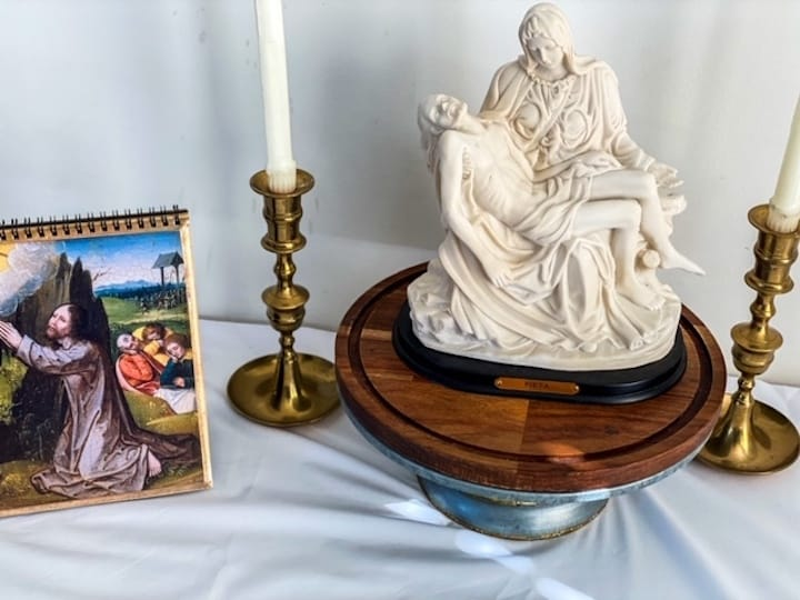 statues and blessed candles