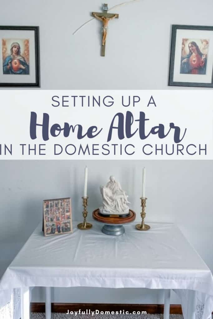 a view of our catholic home altar with statues and candles on top with a white linen cloth