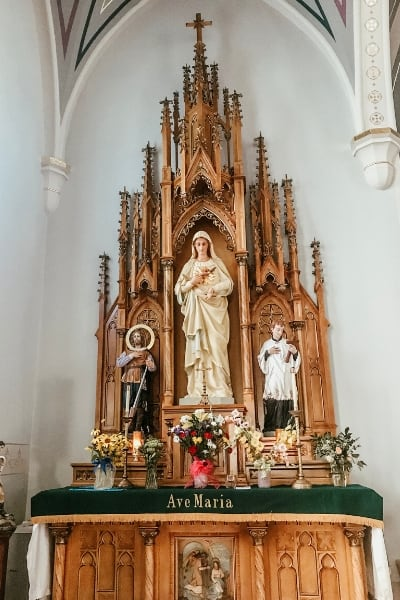 traditional catholic altar in church with Blessed Mother statue