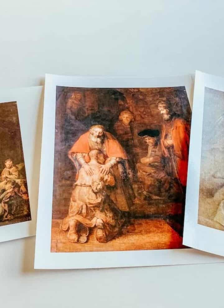 scattered images of Rembrandt paintings on the table