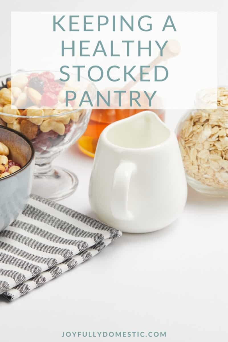 white creamer and bowls of dried fruits, oats, and honey