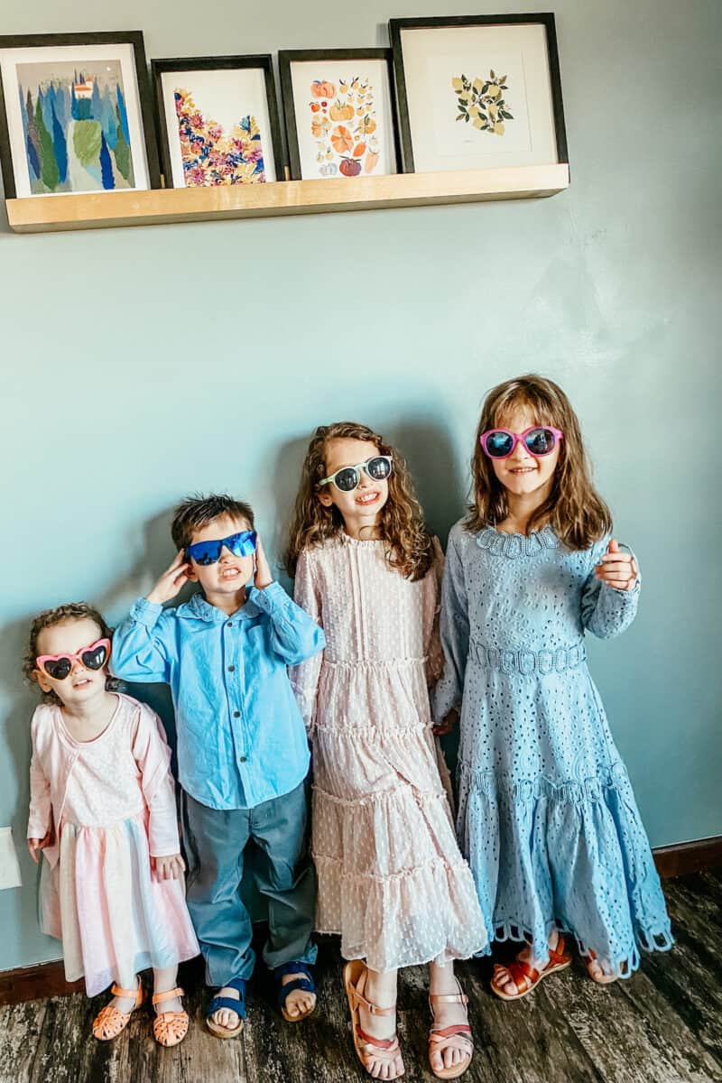 kids in their easter outfits and wearing sunglasses