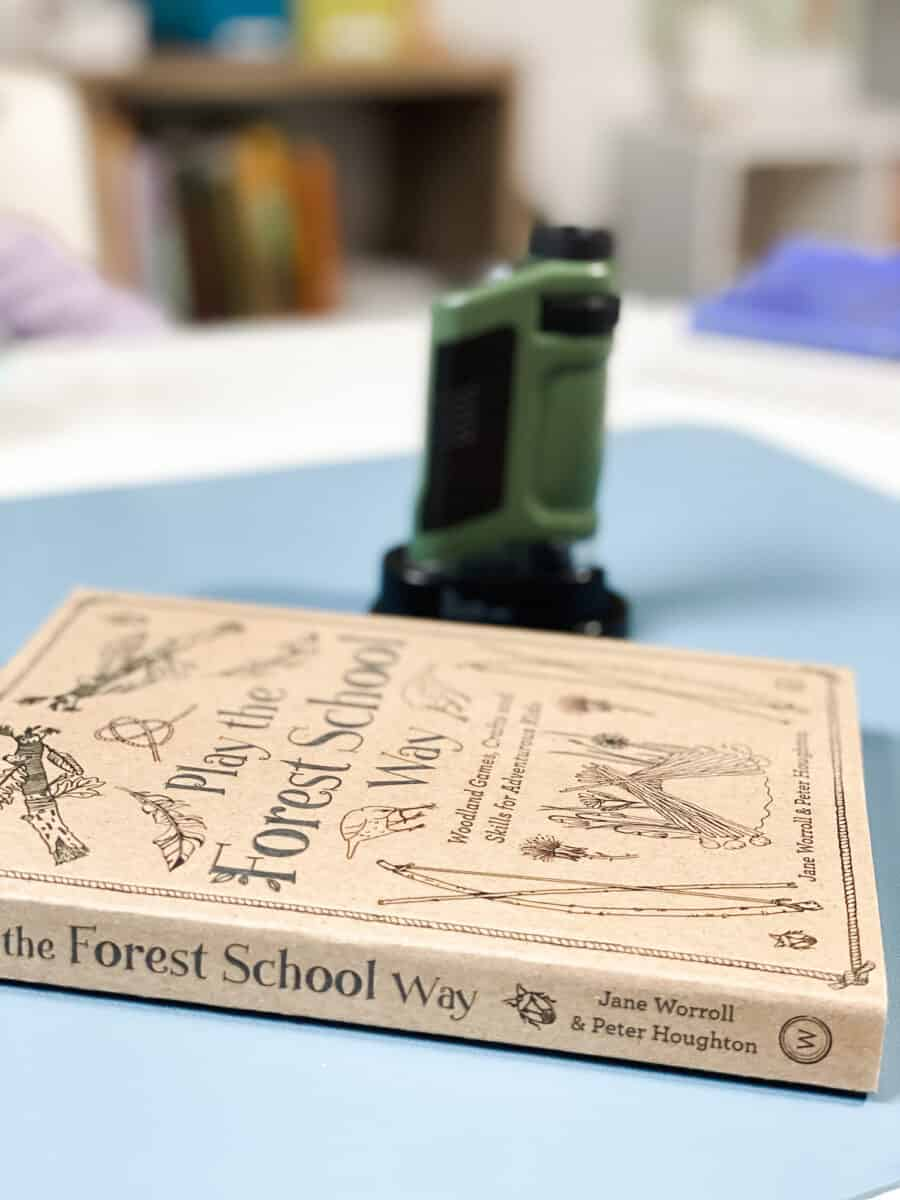 pocket microscope and nature study book on desk in classroom