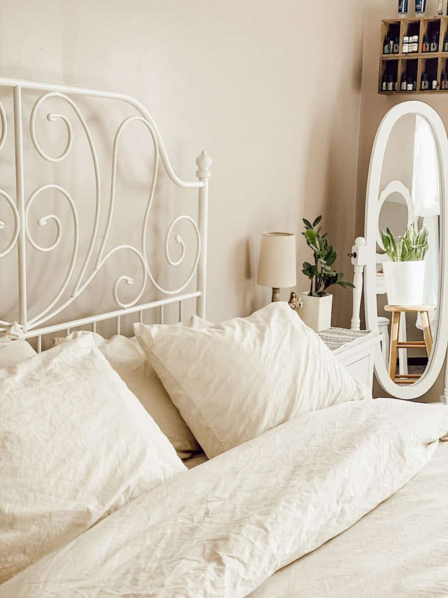 cozy bed with fluffy bedding and pillows