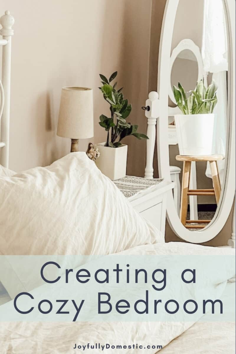 """bedroom view with a text overlay that reads """"creating a cozy bedroom"""""""