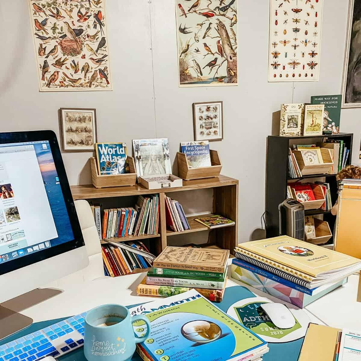 school desk piled with homeschool books and teacher planner